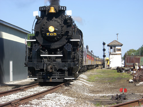 Nickel Plate Road 765 rolls past Grasselli Tower